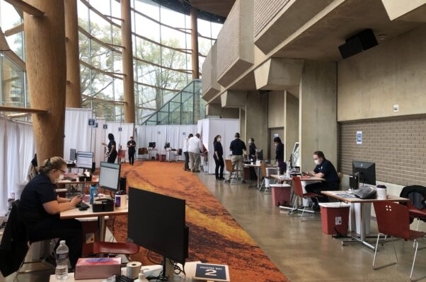 People at Arena Stage's COVID-19 vaccination clinic on opening day. (Photo: Arena State/Twitter)