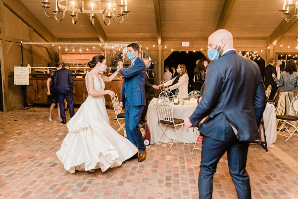 A bride and groom dance at a wedding reception. (Photo: Jennifer Larsen Photography)