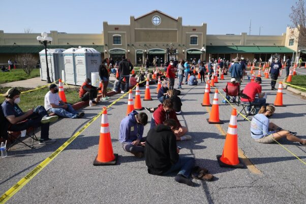 People wait in line in early-April outside the Hagerstown Prime Outlets mass vaccination center. (Photo: Chip Somodevilla/Getty Images)