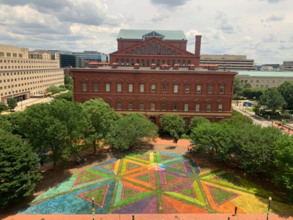 """""""Equalateral Network,"""" a series of pink triangles and walking paths painted on the ground outside the National Building Museum. (Photo: Courtesy of Lisa Marie Thalhammer)"""