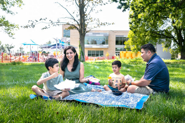 A Hispanic family having a picnic in Wheaton Local Park. (Photo: Montgomery Parks)