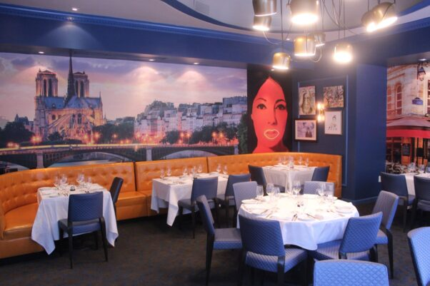 The private dining room with custom murals of Notre-Dame (left) and the Left Bank (right). (Photo: Mark Heckathorn/DC on Heels)