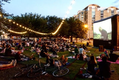 People watching a movie at Can I Kick It? on the lawn of the National Building Museum. (Photo: Shaolin Jazz/Facebook)