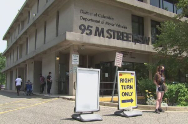 People waiting in line outside the main D.C. DMV office at 95 M St. SW. (Photo; Fox 5 DC)