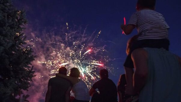 A family watches fireworks in the sky near Cincinnati, Ohio, on July 1, 2018. (Photo: David Gifreda/Cincinnati Enquirer)