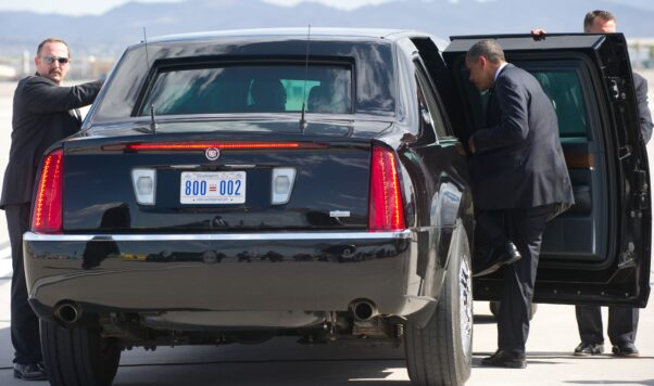 President Obama gets into a black presidential limo with D.C. license plates on it. (Photo: CBS News)