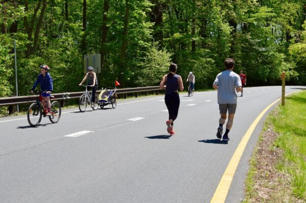 People running and biking on one of Montgomery County's Open Streets. (Photo: Montgomery Parks)