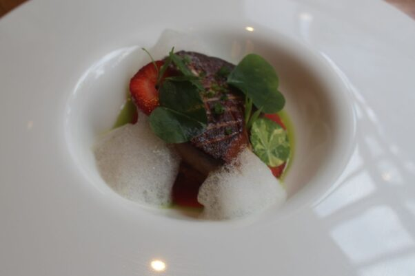 Seared Hudson Valley foie gras with brioche, buttermilk, local strawberries and Champagne in a white bowl. (Photo: Mark Heckathorn/DC on Heels)
