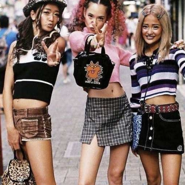 Three Asian girls with long hair wearing crop tops and mini skirts. (Photo: Pinterest)