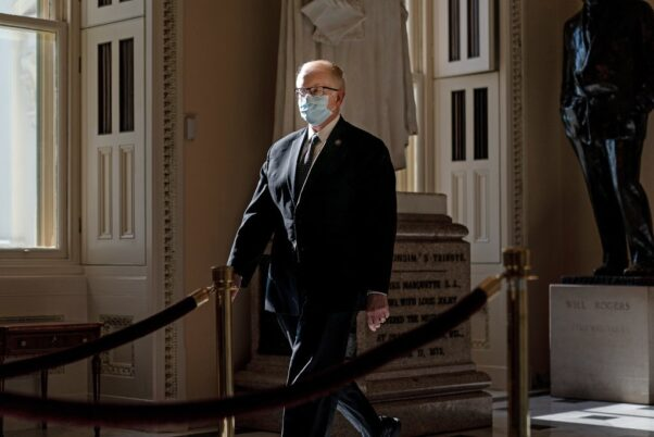 U.S. Capitol Attending Physician Dr. Brian Monahan walks through the Capitol wearing a face mask. (Photo: Erin Schaff/New York Times)
