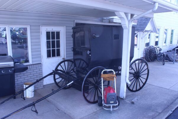 A completed black Amish buggy sitting outside the shop waiting to be picked up. (Photo: Mark Heckathorn/DC on Heels)